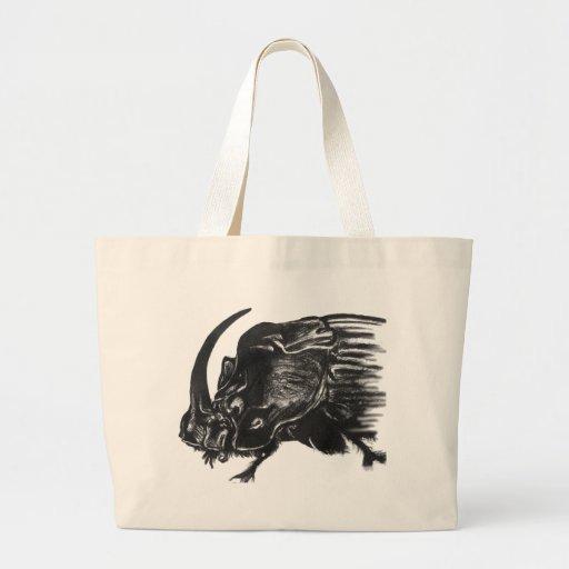 Black hand drawn rhino beetle tote bag