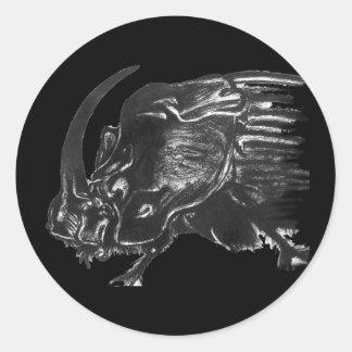 Black hand drawn rhino beetle round sticker