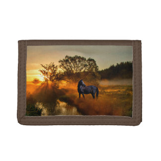 Black horse at sunrise or sunset tri-fold wallet