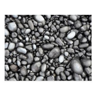 Black lava pebbles pattern postcard