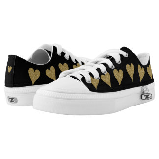 Black low tops with gold hearts printed shoes
