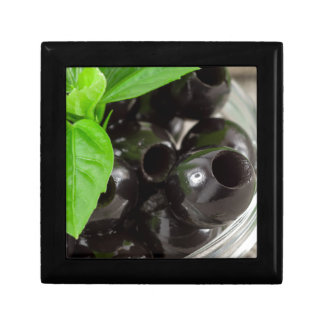 Black olives, pitted marinated in a glass bowl gift box