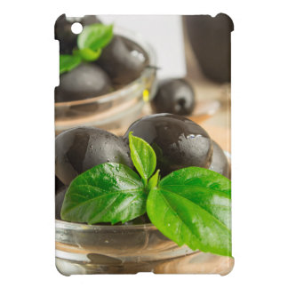 Black olives with green leaves with vintage cover for the iPad mini