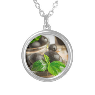 Black olives with green leaves with vintage silver plated necklace