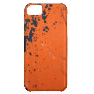 Black paint splatter on orange iPhone 5C case
