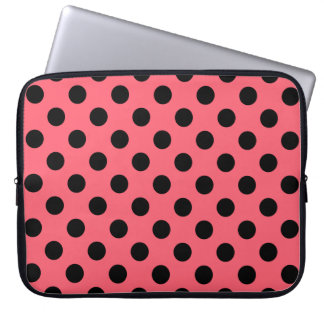 Black polka dots on coral computer sleeves