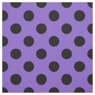 Black polka dots on lavender fabric