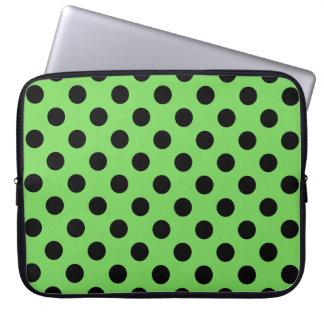 Black polka dots on lime green computer sleeve