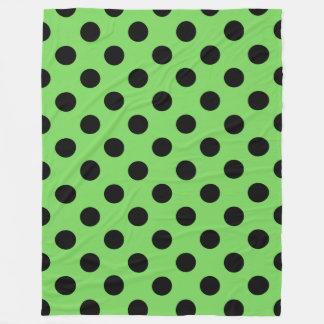 Black polka dots on lime green fleece blanket