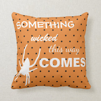 Black polka dots on orange background spider cushion