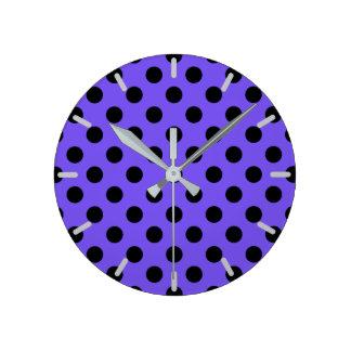 Black polka dots on periwinkle clocks