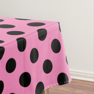 Black polka dots on pink tablecloth