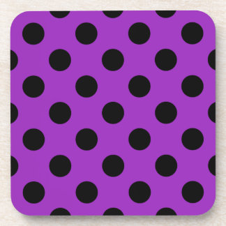 Black polka dots on purple drink coaster