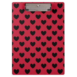 Black polka hearts on red clipboard