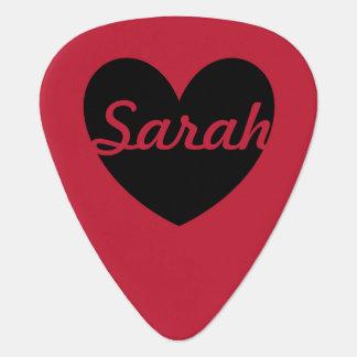 Black polka hearts on red guitar pick