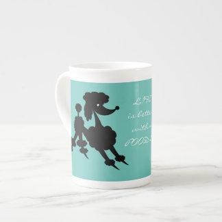 Black Poodle on Teal Tea Cup