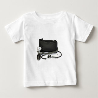 Black professional blood pressure monitor on white baby T-Shirt