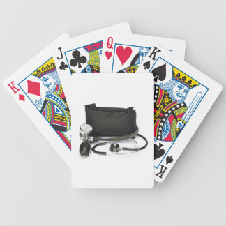 Black professional blood pressure monitor on white bicycle playing cards