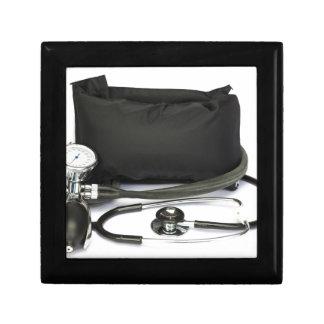 Black professional blood pressure monitor on white gift box