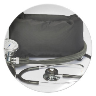 Black professional blood pressure monitor on white plate