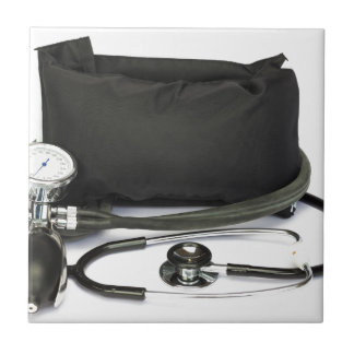Black professional blood pressure monitor on white tile