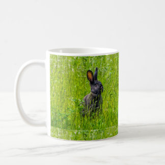 Black rabbits in the grass mug