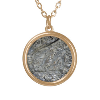 Black rock surface with irregular patterns necklaces