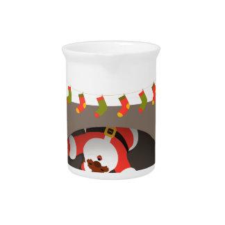 black santa stuck in fireplace pitcher