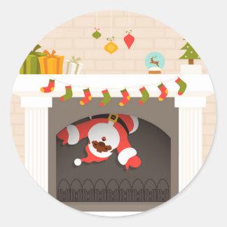 black santa stuck in fireplace round sticker