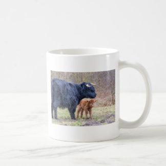 Black Scottish highlander mother cow with newborn Coffee Mug