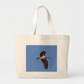 Black stork (Ciconia nigra) in flight Large Tote Bag