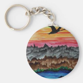Black swans at sunset key ring