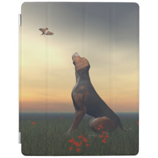 Black tan dog looking a bird flying iPad cover