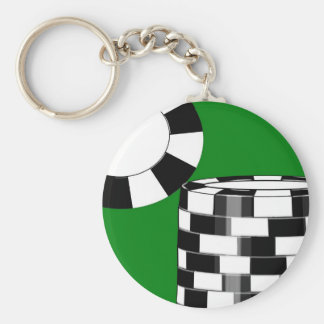Black white poker chips on green key ring