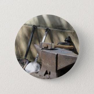 Blacksmith hammer resting on the anvil 6 cm round badge