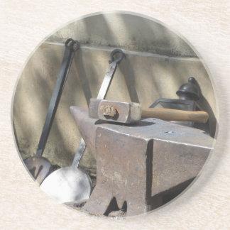 Blacksmith hammer resting on the anvil coaster