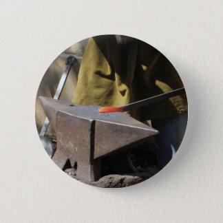Blacksmith manually forging the molten metal 6 cm round badge