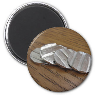 Blank metallic coins on wooden table 6 cm round magnet