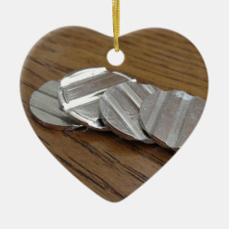 Blank metallic coins on wooden table ceramic heart decoration