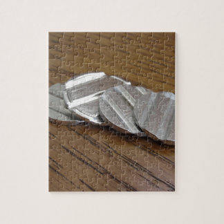 Blank metallic coins on wooden table jigsaw puzzle
