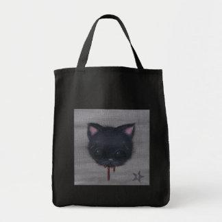 bleeding cat tote bag