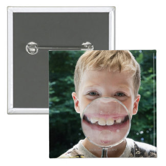 blond boy behind magnifying glass smiling 15 cm square badge