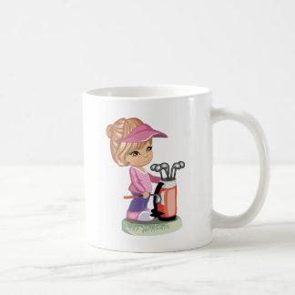 Blond little girl playing golf mug