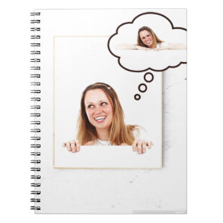 Blonde Woman Thinking on White Board Notebook