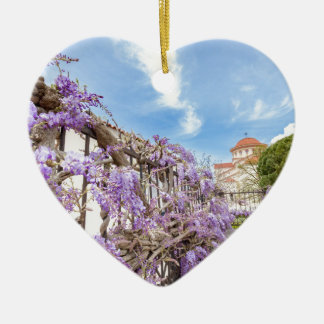 Blooming blue Wisteria sinensis on fence in Greece Ceramic Heart Decoration