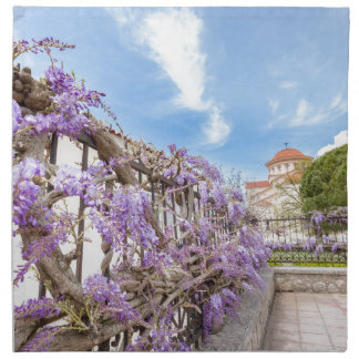Blooming blue Wisteria sinensis on fence in Greece Printed Napkins