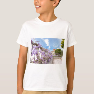 Blooming blue Wisteria sinensis on fence in Greece T-Shirt