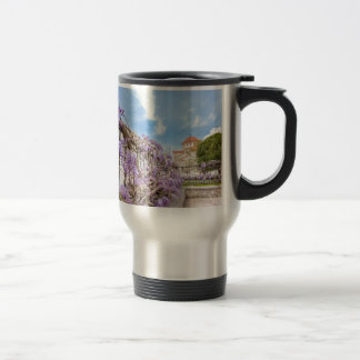 Blooming blue Wisteria sinensis on fence in Greece Travel Mug