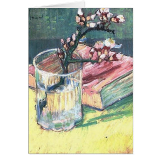Blossoming Almond Branch in a glass and a book Card