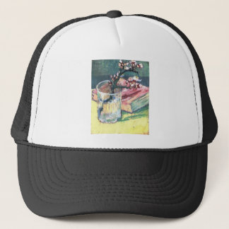 Blossoming Almond Branch in a glass and a book Trucker Hat